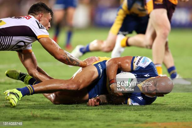 Blake Ferguson of the Eels is tackled during the round seven NRL match between the Parramatta Eels and the Brisbane Broncos at TIO Stadium, on April...