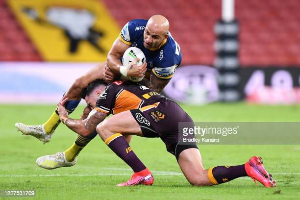 Blake Ferguson of the Eels is tackled during the round three NRL match between the Brisbane Broncos and the Parramatta Eels at Suncorp Stadium on May...