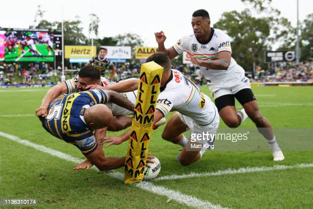 Blake Ferguson of the Eels is tackled into touch on the try line during the round one NRL match between the Penrith Panthers and the Parramatta Eels...