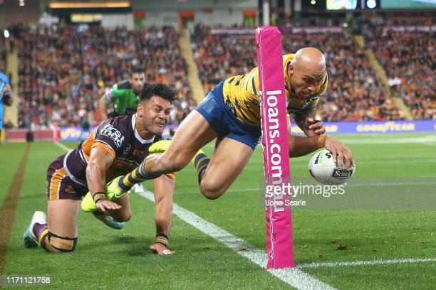 Blake Ferguson of the Eels scores a try during the round 24 NRL match between the Brisbane Broncos and Parramatta Eels at Suncorp Stadium on August...