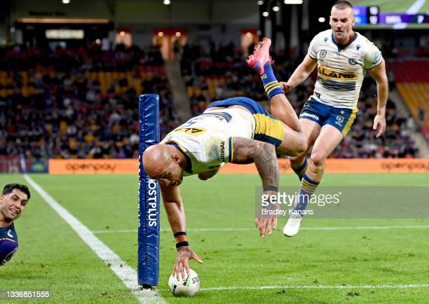 Blake Ferguson of the Eels scores a try during the round 24 NRL match between the Melbourne Storm and the Parramatta Eels at Suncorp Stadium, on...
