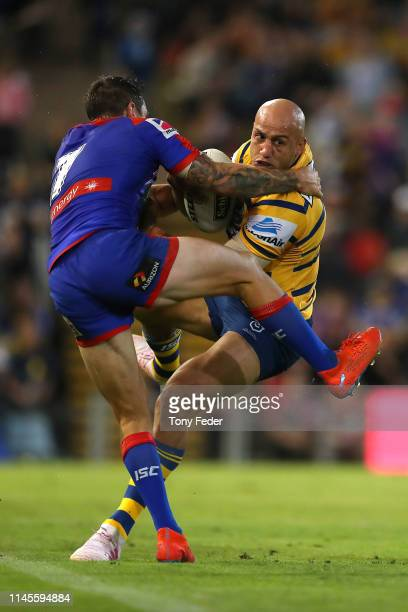 Blake Ferguson of the Parramatta Eels is tackled by Mitchell Pearce of the Newcastle Knights during the round 7 NRL match between the Newcastle...