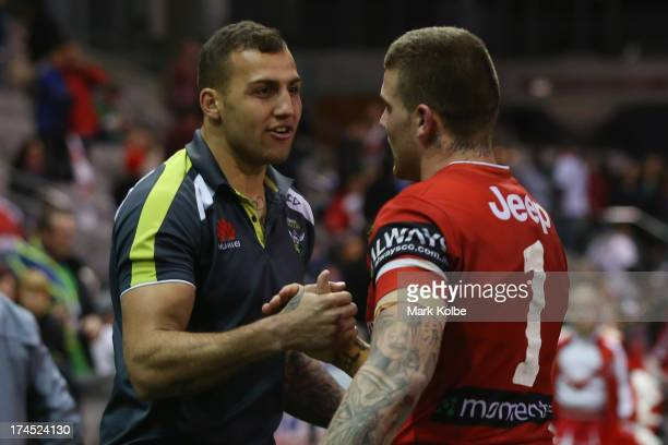 Blake Ferguson of the Raiders and Josh Dugan of the Dragons shake hands at the end of the round 20 match between the St George Illawarra Dragons and...
