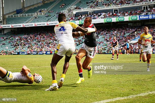 Blake Ferguson of the Roosters beats Edrick Lee of the Raiders to score a try during the round four NRL match between the Sydney Roosters and the...