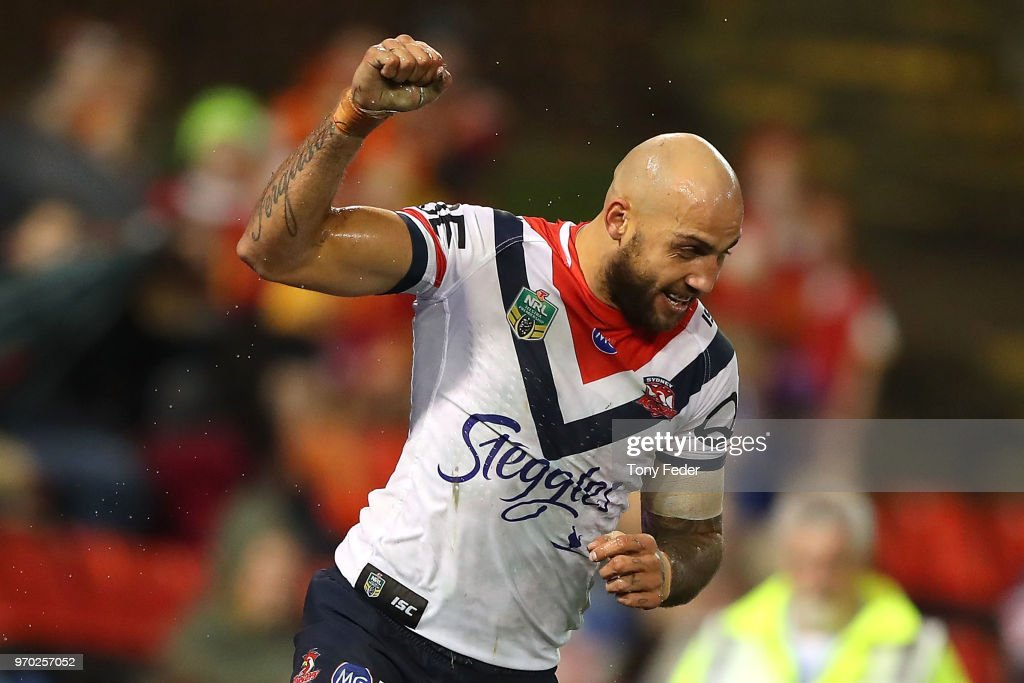 Blake Ferguson of the Roosters celebrates a try during the round 14 NRL match between the Newcastle Knights and the Sydney Roosters at McDonald Jones Stadium on June 9, 2018 in Newcastle, Australia.