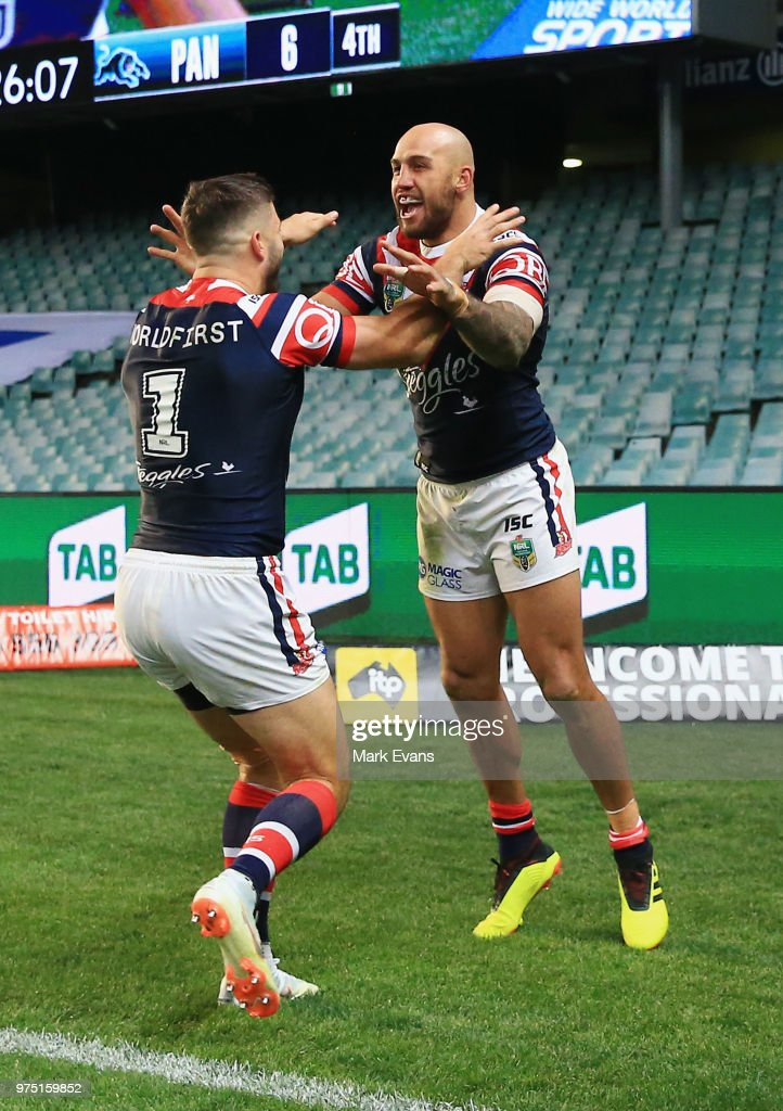 Blake Ferguson of the Roosters (R) celebrates a try with James Tedesco during the round 15 NRL match between the Sydney Roosters and the Penrith Panthers at Allianz Stadium on June 15, 2018 in Sydney, Australia.