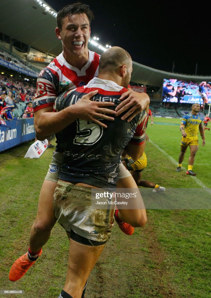 Blake Ferguson of the Roosters celebrates with Joseph Manu after scoring a try during the round 10 NRL match between the Sydney Roosters and the Parramatta Eels at Allianz Stadium on May 14, 2017 in Sydney, Australia.