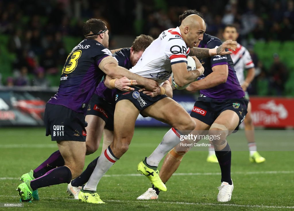 Blake Ferguson of the Roosters is challenged during the round 23 NRL match between the Melbourne Storm and the Sydney Roosters at AAMI Park on August 12, 2017 in Melbourne, Australia.