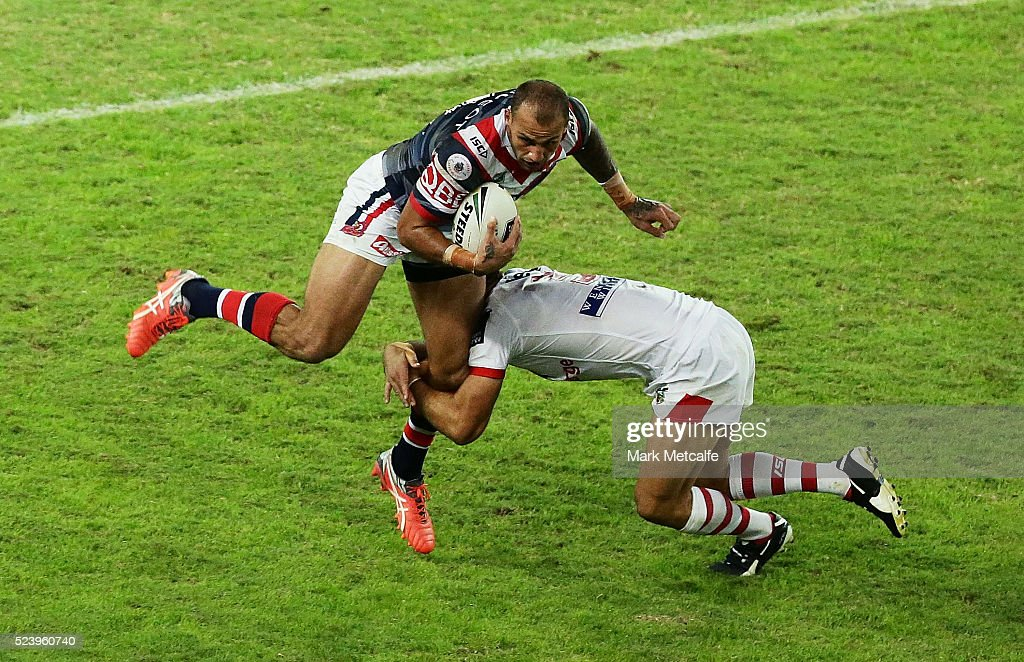 Blake Ferguson of the Roosters is tackled by Jason Nightingale of the Dragons during the round eight NRL match between the St George Illawarra Dragons and the Sydney Roosters at Allianz Stadium on April 25, 2016 in Sydney, Australia.