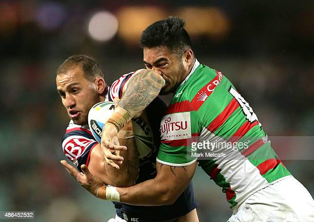Blake Ferguson of the Roosters is tackled by kirisome Auva'a of the Rabbitohs during the round 26 NRL match between the Sydney Roosters and the South...