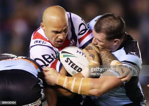 Blake Ferguson of the Roosters is tackled by Paul Gallen of the Sharks during the round 25 NRL match between the Cronulla Sharks and the Sydney...