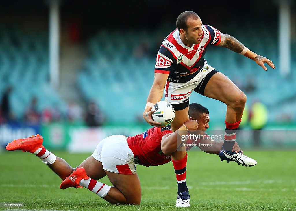 Blake Ferguson of the Roosters is tackled by Taane Milne of the Dragons during the round 24 NRL match between the Sydney Roosters and the St George Illawarra Dragons at Allianz Stadium on August 21, 2016 in Sydney, Australia.