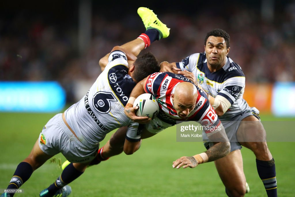 Blake Ferguson of the Roosters is tackled by Te Maire Martin and Justin O'Neill of the Cowboys during the NRL Preliminary Final match between the Sydney Roosters and the North Queensland Cowboys at Allianz Stadium on September 23, 2017 in Sydney, Australia.