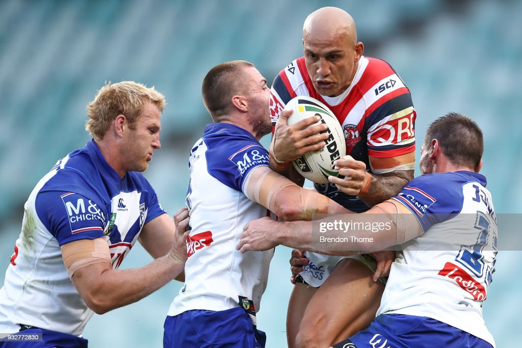 Blake Ferguson of the Roosters is tackled by the Bulldogs defence during the round two NRL match between the Sydney Roosters and the Canterbury Bulldogs at Allianz Stadium on March 16, 2018 in Sydney, Australia.