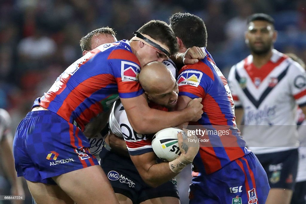 Blake Ferguson of the Roosters is tackled by the Knights defence during the round seven NRL match between the Newcastle Knights and the Sydney Roosters at McDonald Jones Stadium on April 14, 2017 in Newcastle, Australia.