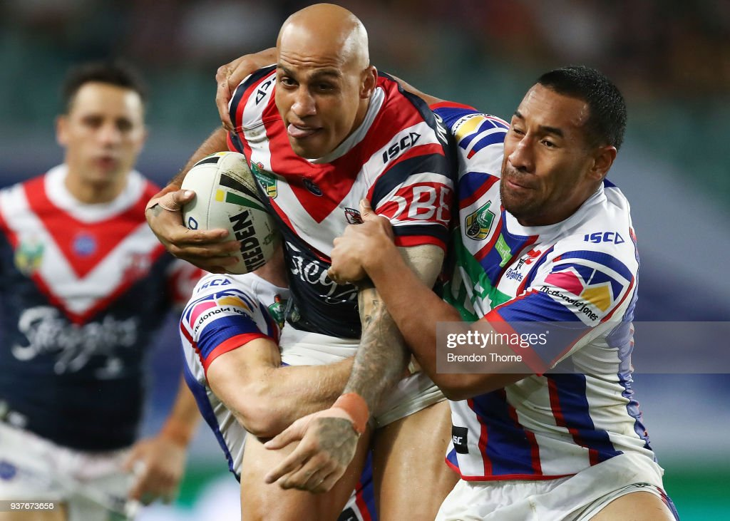 Blake Ferguson of the Roosters is tackled by the Knights defence during the round three NRL match between the Sydney Roosters and the Newcastle Knights at Allianz Stadium on March 25, 2018 in Sydney, Australia.