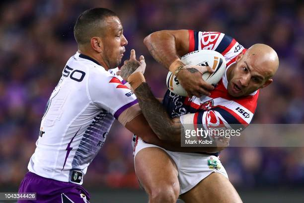 Blake Ferguson of the Roosters is tackled by Will Chambers of the Storm during the 2018 NRL Grand Final match between the Melbourne Storm and the...