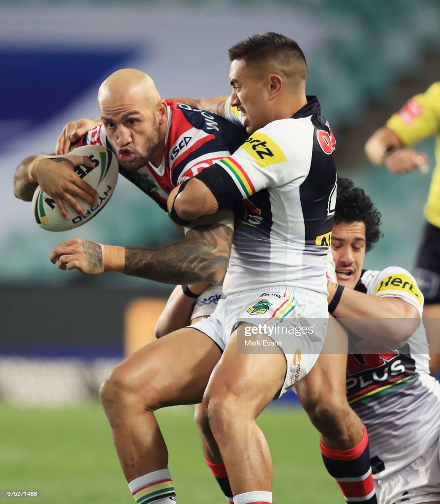 Blake Ferguson of the Roosters is tackled during the round 15 NRL match between the Sydney Roosters and the Penrith Panthers at Allianz Stadium on June 15, 2018 in Sydney, Australia.