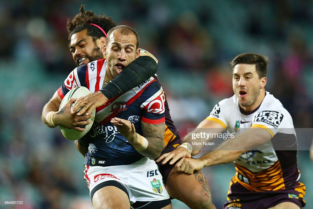 Blake Ferguson of the Roosters is tackled during the round 21 NRL match between the Sydney Roosters and the Brisbane Broncos at Allianz Stadium on July 28, 2016 in Sydney, Australia.