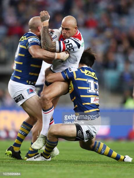 Blake Ferguson of the Roosters is tackled during the round 25 NRL match between the Parramatta Eels and the Sydney Roosters at ANZ Stadium on...