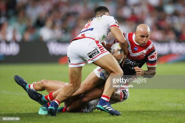 Blake Ferguson of the Roosters is tackled during the round eight NRL match between the St George Illawara Dragons and Sydney Roosters at Allianz...