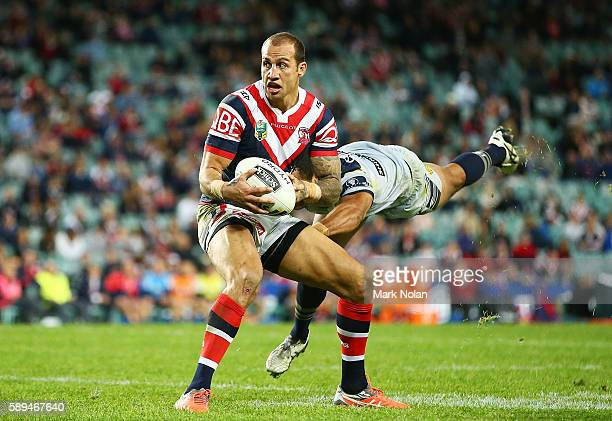 Blake Ferguson of the Roosters runs the ball during the round 23 NRL match between the Sydney Roosters and the North Queensland Cowboys at Allianz...