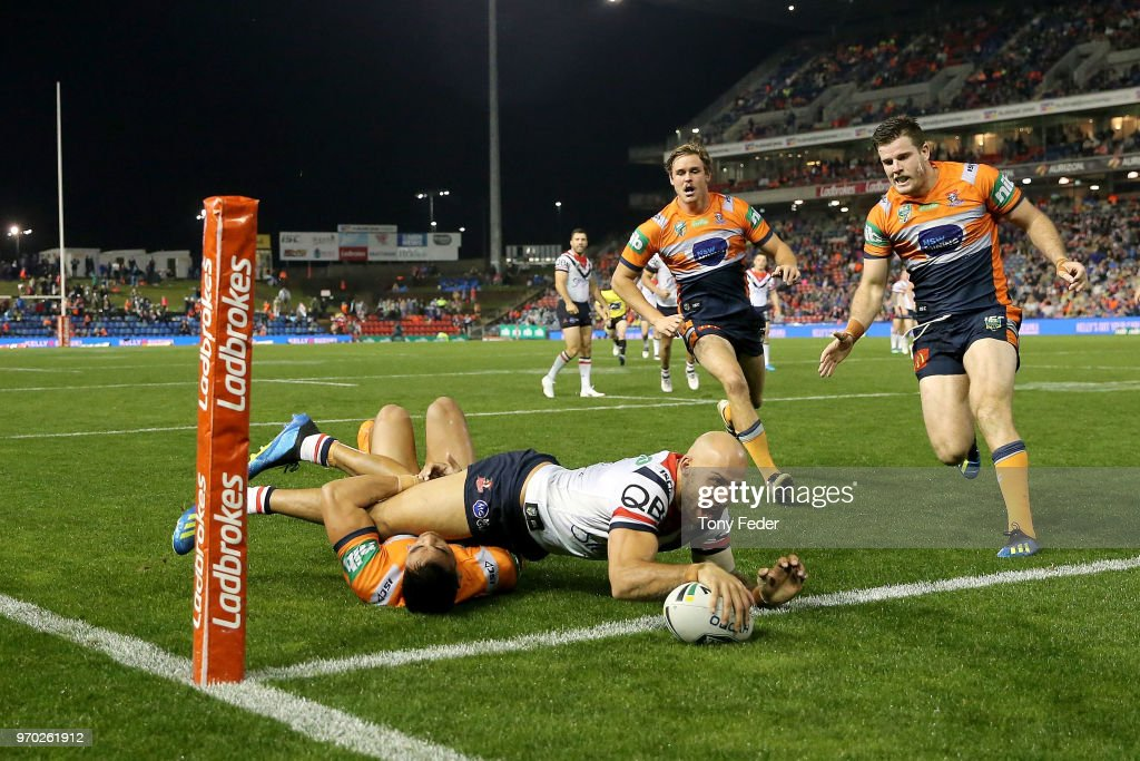 Blake Ferguson of the Roosters scores a try during the round 14 NRL match between the Newcastle Knights and the Sydney Roosters at McDonald Jones Stadium on June 9, 2018 in Newcastle, Australia.