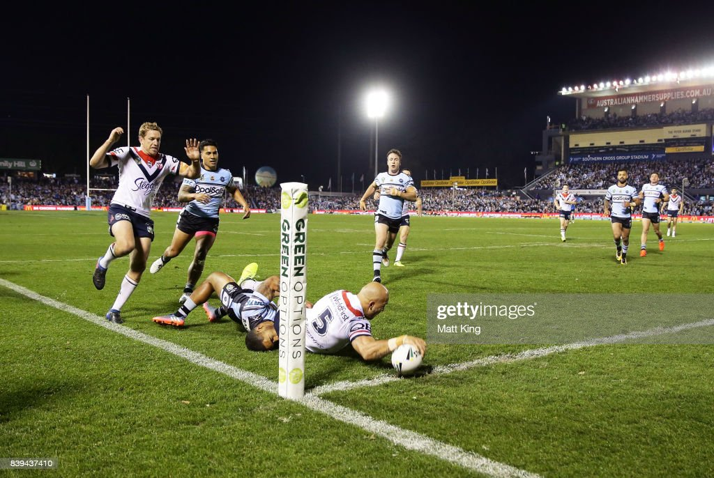 Blake Ferguson of the Roosters scores a try during the round 25 NRL match between the Cronulla Sharks and the Sydney Roosters at Southern Cross Group Stadium on August 26, 2017 in Sydney, Australia.