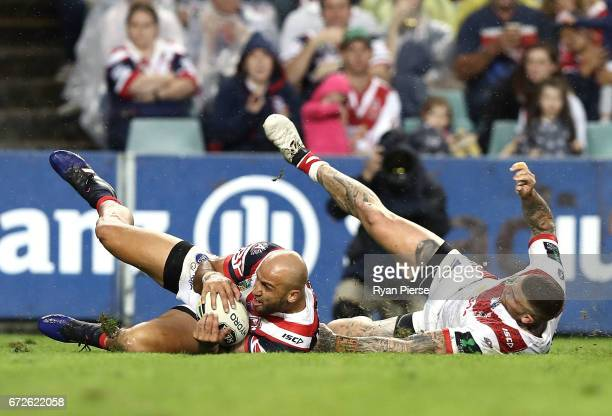 Blake Ferguson of the Roosters scores a try during the round eight NRL match between the Sydney Roosters and the St George Illawarra Dragons at...