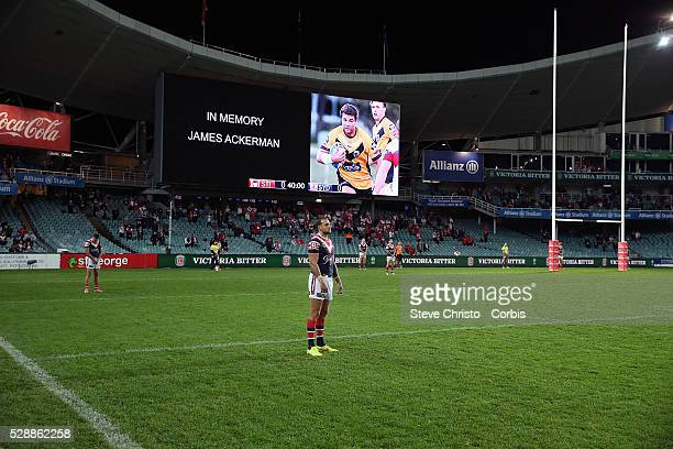 Blake Ferguson of the Roosters stands for a minutes silence after the passing of James Ackerman before the round 15 NRL match between the Sydney...