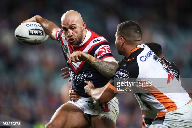 Blake Ferguson of the Roosters takes on the defence during the round 13 NRL match between the Sydney Roosters and the Wests Tigers at Allianz Stadium...