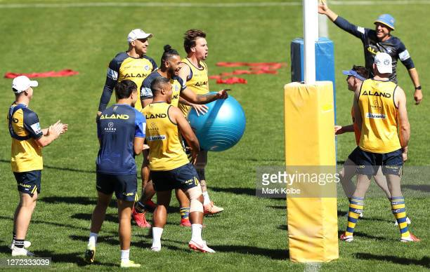 Blake Ferguson, Waqa Blake, Clinton Gutherson and Michael Jennings celebrate a poin tin a game of volleyball during a Parramatta Eels NRL training...