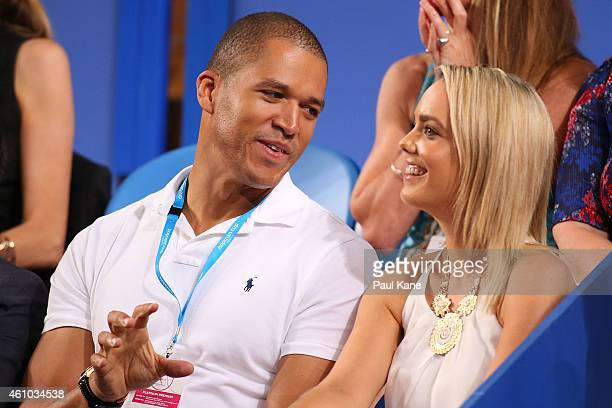 Blake Garvey and Louise Pillidge watch the action during day two of the 2015 Hopman Cup at Perth Arena on January 5 2015 in Perth Australia