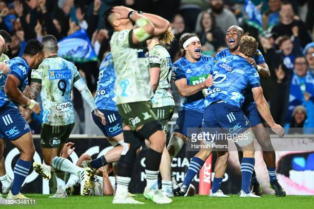 Blake Gibson of the Blues celebrates after scoring a try during the Super Rugby Trans-Tasman Final match between the Blues and the Highlanders at...