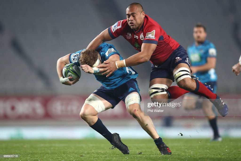 Blake Gibson of the Blues is tackled by Caleb Timu of the Reds during the round 17 Super Rugby match between the Blues and the Reds at Eden Park on June 29, 2018 in Auckland, New Zealand.
