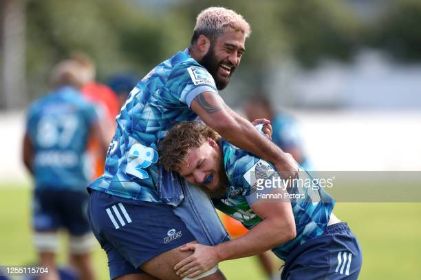 Blake Gibson of the Blues tackles Akira Ioane of the Blues during a Blues Super Rugby training session at Blues HQ on July 09, 2020 in Auckland, New...