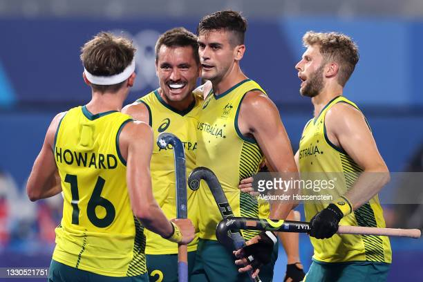 Blake Govers of Team Australia celebrates with teammates after scoring their team's sixth goal during the Men's Preliminary Pool A match between...