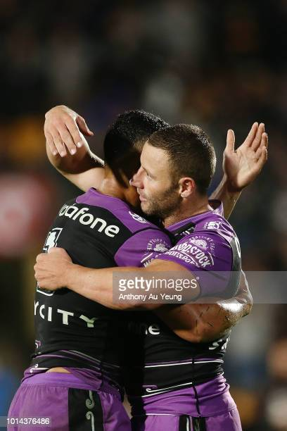 Blake Green and Roger TuivasaSheck of the Warriors share a hug after winning the round 22 NRL match between the New Zealand Warriors and the...