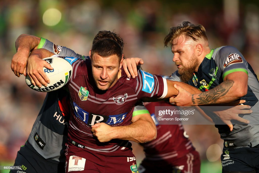 Blake Green of the Sea Eagles is tackled during the round 13 NRL match between the Manly Sea Eagles and the Canberra Raiders at Lottoland on June 4, 2017 in Sydney, Australia.