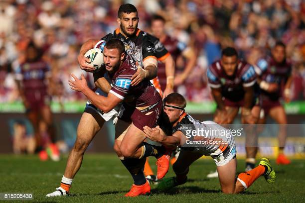 Blake Green of the Sea Eagles is tackled during the round 19 NRL match between the Manly Sea Eagles and the Wests Tigers at Lottoland on July 16 2017...