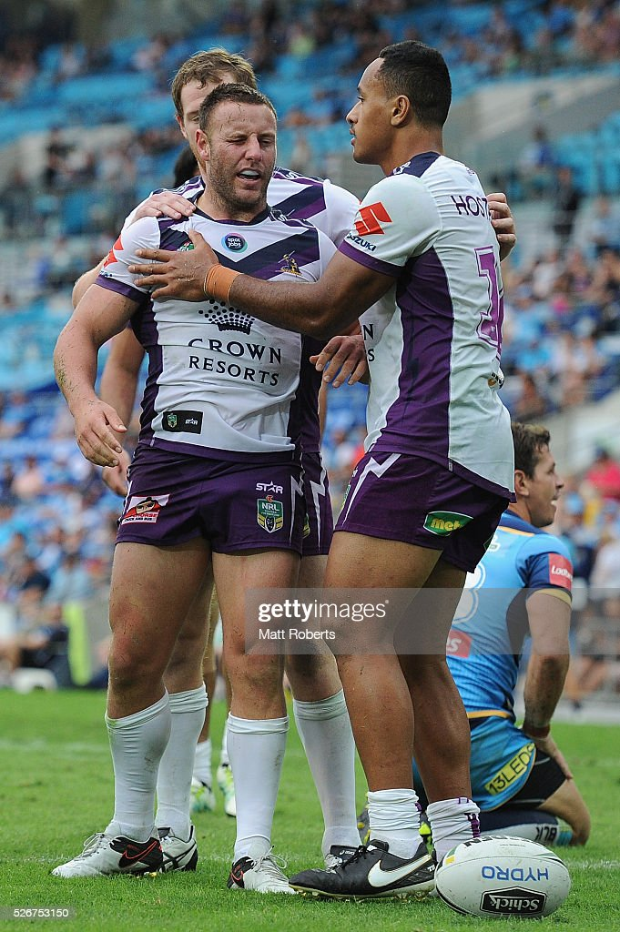 Blake Green of the Storm celebrates scoring a try with team mates during the round nine NRL match between the Gold Coast Titans and the Melbourne Storm on May 1, 2016 in Gold Coast, Australia.