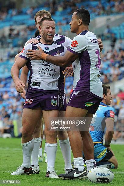 Blake Green of the Storm celebrates scoring a try with team mates during the round nine NRL match between the Gold Coast Titans and the Melbourne...