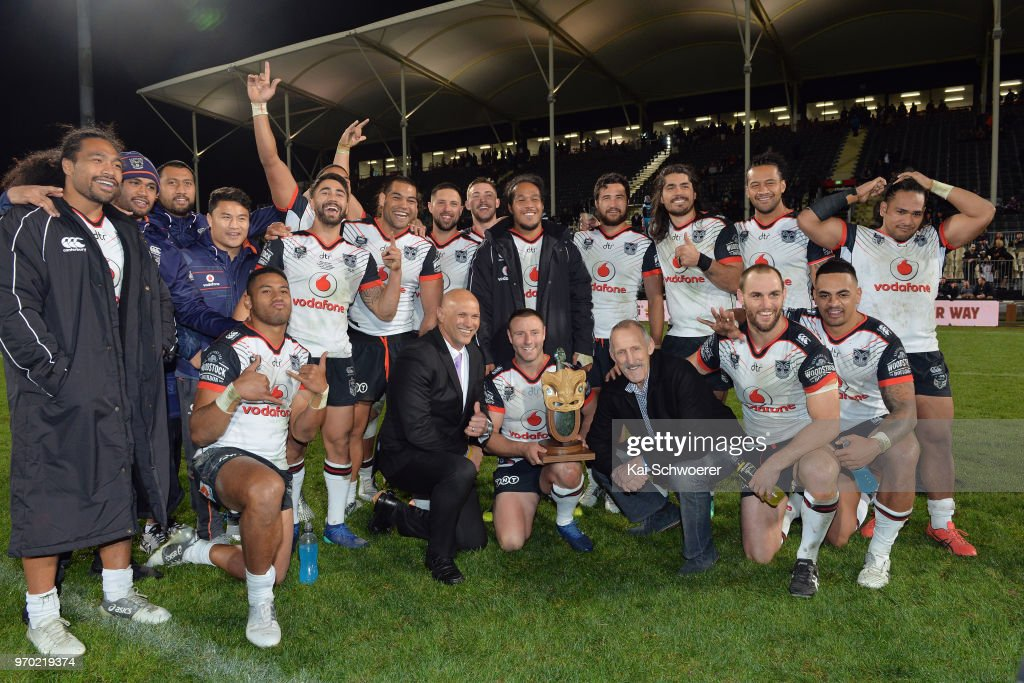 Blake Green of the Warriors (C) and his team mates pose with the Broadhurst-Shelford Trophy after their win in the round 14 NRL match between the Manly Sea Eagles and the New Zealand Warriors at AMI Stadium on June 9, 2018 in Christchurch, New Zealand.