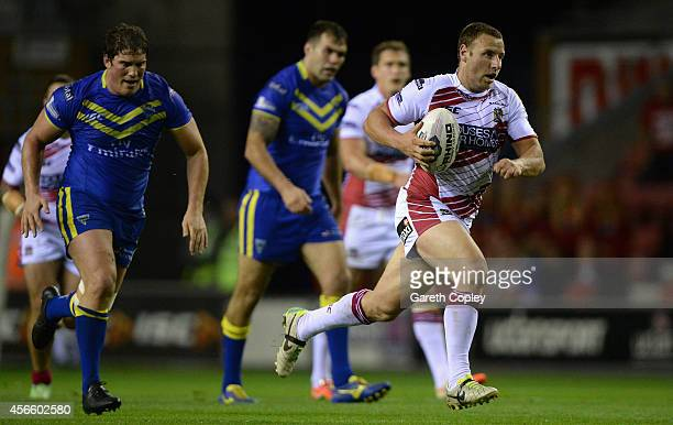 Blake Green of Wigan Warriors makes a break down field during the First Utility Super League Qualifying SemiFinal match between Wigan Warriors and...