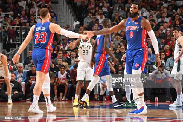 Blake Griffin and Andre Drummond of the Detroit Pistons high five during Game Four of Round One of the 2019 NBA Playoffs against the Milwaukee Bucks...