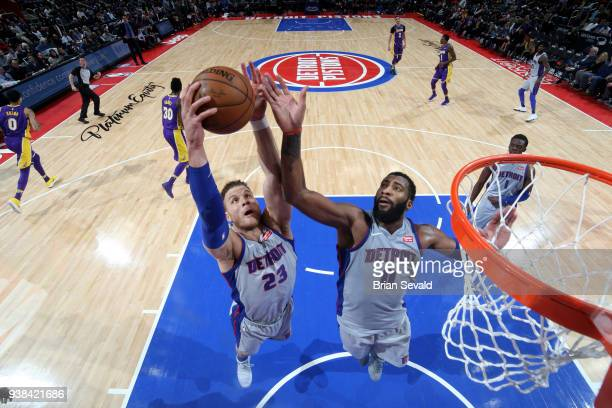 Blake Griffin and Andre Drummond of the Detroit Pistons reach for the rebound during the game against the Los Angeles Lakers on March 26 2018 at...