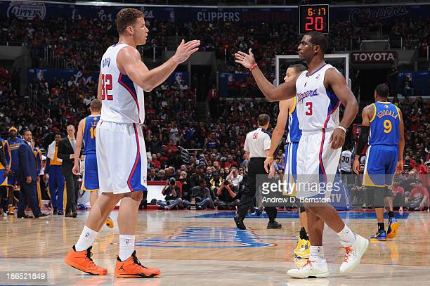 Blake Griffin and Chris Paul of the Los Angeles Clippers highfive during a game against the Golden State Warriors at STAPLES Center on October 31...