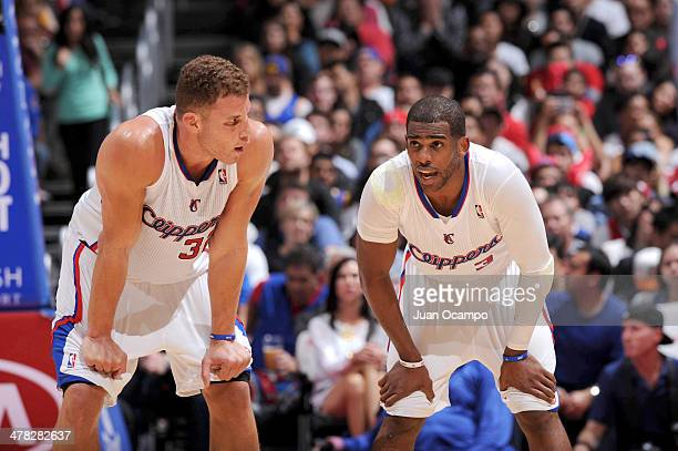 Blake Griffin and Chris Paul of the Los Angeles Clippers speak to each other during their game against the Golden State Warriors at Staples Center on...