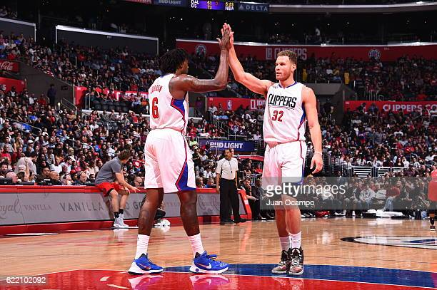 Blake Griffin and DeAndre Jordan of the Los Angeles Clippers high five during the game against the Portland Trail Blazers on November 9 2016 at...