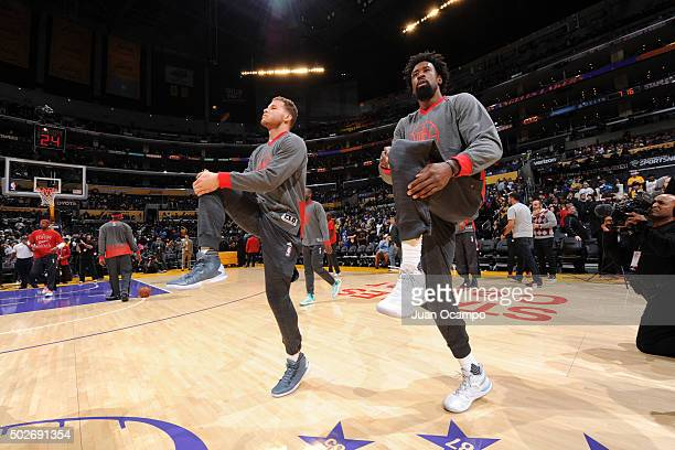 Blake Griffin and DeAndre Jordan of the Los Angeles Clippers warm up before the game against the Los Angeles Lakers at Staples Center on December 25...